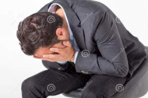businessman-crying-mid-adult-sitted-44588576